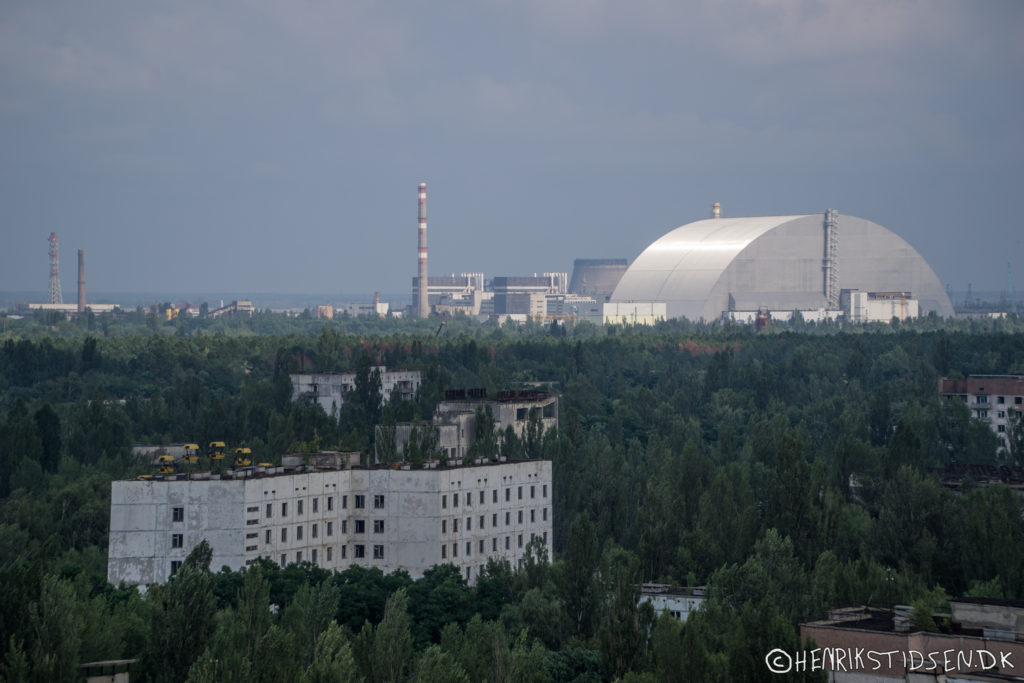 Prypiat with the nuclear plant in the horizon