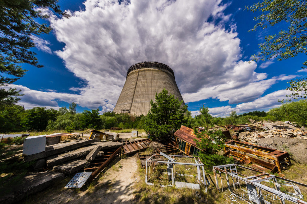 Dramatic photo of a cooling tower with clouds above